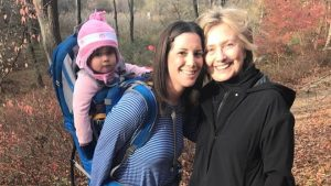Hillary walking in Woods after election met by supporter